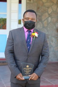 Independence Day honoree Mr. Troy McKoy with his plaque in honour of his 25-year contribution to Business on Nevis following an awards ceremony at Government House on September 20, 2021, on the occasion of the 38th Anniversary of Independence of St. Christopher and Nevis
