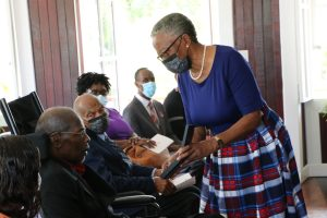 Her Honour Mrs. Hyleeta Liburd, Deputy Governor General on Nevis presents Dr. Albert Linton Liburd Sr. with the 2020 Medal of Honour for his outstanding contribution to National Service in the field of Medicine at an Investiture Ceremony at Government House at Bath Plain on September 09, 2021