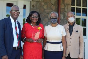 Independence Day honouree retired registered nurse Mrs. Ernette Manners (second from left) showing off her award flanked by her brother Mr. Oral Brandy (left) and Her Honour Mrs. Hyleeta Liburd, Deputy Governor General on Nevis, (second from right) and her husband following an awards ceremony at Government House on September 20, 2021