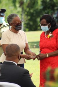 Her Honour Mrs. Hyleeta Liburd, Deputy Governor General on Nevis, presenting Independence Day honoree retired registered nurse Mrs. Ernette Manners with a plaque at an awards ceremony at Government House on September 20, 2021