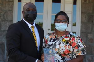 Ms. Christiana Smith from Fountain Village with Hon. Alexis Jeffers, Area Representative for St. James' Parish, showing off the award she received for Community Service on the occasion of the 38th Anniversary of Independence of St. Christopher and Nevis at an awards ceremony at Government House on September 20, 2021