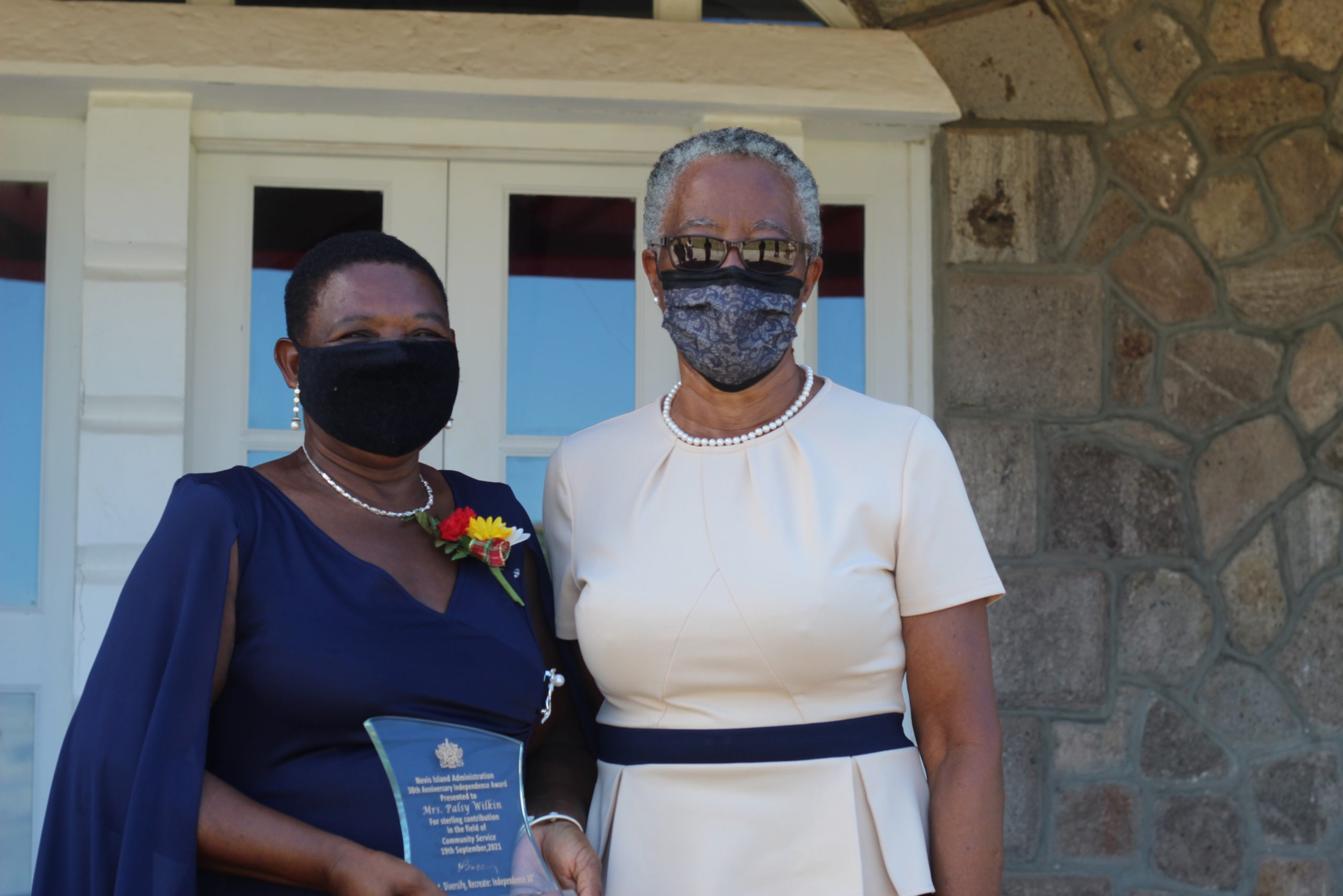 (L-r) Mrs. Palsy Wilkin with Her Honour Mrs. Hyleeta Liburd, Deputy Governor General on Nevis at the end of an Awards Ceremony at Government House on September 20, 2021. Mrs Wilkin was one of 11 Nevisians presented with a plaque by Her Honour for their sterling contributions in St. Kitts and Nevis on the occasion of the Federation's 38th Anniversary of Independence