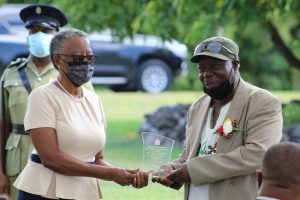 """Mr. Eugene """"Chevy"""" Chiverton of Brown Hill Village receiving a plaque in recognition of his contribution in the field of Culture from Her Honour Mrs. Hyleeta Liburd, Deputy Governor General in Nevis at an Awards Ceremony on September 20, 2021, at Government House on the occasion of the 38th Anniversary of Independence of St. Christopher and Nevis"""