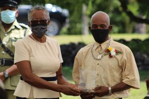 Her Honour Mrs. Hyleeta Liburd, Deputy Governor General in Nevis presenting a plaque to Mr. Orville Hendrickson on behalf of Independence Day honoree Mr. Elton Archibald for his contribution to Culture at an Awards Ceremony at Government House on September 20, 2021, on the occasion of the 38th Anniversary of the Independence of St. Christopher and Nevis