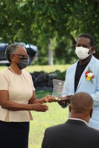 Mr. Curtley Maynard of Gingerland receiving a plaque from Her Honour Mrs Hyleeta Liburd for his contribution to the development of Music at an Awards Ceremony on September 20, 2021, at an Awards Ceremony at Government House on the occasion of the 38th Anniversary of Independence of St. Christopher and Nevis
